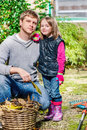 Autumnal garden father and daughter in Stock Photo