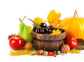 Autumnal harvest fruits and vegetables with yellow leaves on white background Royalty Free Stock Photography