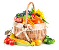 Autumnal harvest vegetables and fruits in basket vegetable fruit on white background Stock Images