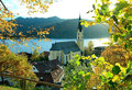 Autumnal view through branches to schliersee lake and church upper bavaria germany Royalty Free Stock Photography