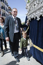 Auxiliary throne or called contraguia accompanied by his son in a procession of holy week spain Royalty Free Stock Photo