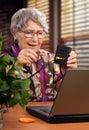 AV splitter-switcher is held by retired woman