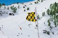 Avalanche warning flag with ski slope and piste on background Stock Photos