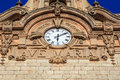 Ave maria clock and the text on the face a historic monastery building Royalty Free Stock Image