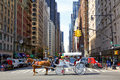 Avenue of the americas new york new york usa may sixth traffic with central park horse carriage crossing intersection Royalty Free Stock Photography