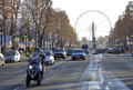 Avenue Champs-Elysees with ferris wheel at horizon in Paris, France