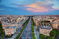 Avenue des champs elysees in paris france view on from arc de triomphe at sunset Royalty Free Stock Images