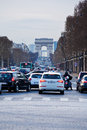 Avenues des champs elysees in paris france march evening traffic on the forms part of the axe historique Stock Images