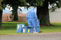 Avian influenza outbreak a technician in full hazmat suit prepares to enter a chicken barn to test for Stock Photography