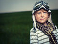 Aviator boy with glasses and helmet in field Royalty Free Stock Images
