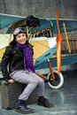 Aviator happy girl ready to travel with plane airplane Royalty Free Stock Photos