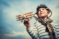 Aviator little boy with wooden plane Royalty Free Stock Photography