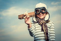 Aviator pilot with plane on a background of the sky Stock Photos