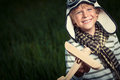 Aviator smiling boy with wooden plane Royalty Free Stock Image