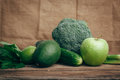 Avocado, apple, lime, celery, cucumber, broccoli, wooden rustic table background Royalty Free Stock Photo