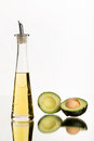Avocado and avocado oil white background clear bottle container healthy cooking oils art in food drink Royalty Free Stock Photo