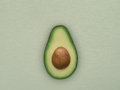 Avocado close up view of nice fresh on green back Royalty Free Stock Photography
