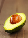 Avocado fruit on brown wooden old table sliced Royalty Free Stock Photos