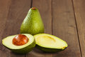 Avocado fruit on brown wooden old table sliced Royalty Free Stock Image