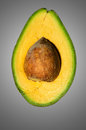 Avocado fruit persea americana or alligator pear refers to the botanically a large berry that contains a single seed Stock Images