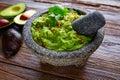 Avocado Guacamole on molcajete real Mexican Royalty Free Stock Photo