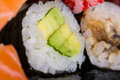 Avocado maki sushi roll with made dish Stock Photography