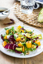 Avocado with Mango,Rocket and Walnut salad Royalty Free Stock Photo