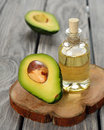 Avocado oil on a gray background Royalty Free Stock Photography