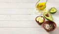 stock image of  Avocado and other ingredients for sauce guacamole on the table.