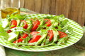 Avocado salad with arugula tomato and olive oil Stock Image