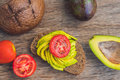 Avocado sandwich with tomato and seasoning on dark rye bread Royalty Free Stock Photo