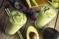 Avocado shake or smoothie being poured into glasses is two this sweet drink is made from avocados blended with ice cream non Royalty Free Stock Image