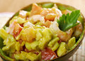 Avocado and shrimps salad closeup Royalty Free Stock Image