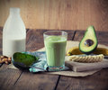 Avocado smoothie with all ingredients on table Royalty Free Stock Image