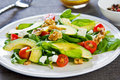 Avocado with spinach and feta salad walnut Royalty Free Stock Images