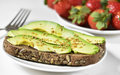 Avocado toast and strawberries Royalty Free Stock Photo