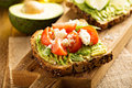 Avocado toast with tomatoes and feta Royalty Free Stock Photo