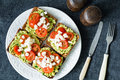 Avocado, tomato and cheese on toast Royalty Free Stock Photo