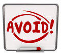 Avoid word written dry erase board warning danger prevention pre and circled on a to illustrate a or sign of things to prevent as Royalty Free Stock Image