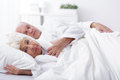 Awaken wife and sleeping husband Royalty Free Stock Photo