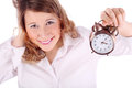 Awakening woman holds alarm clock Stock Photography