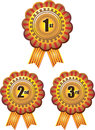 Award ribbon rosettes in three colors isolated on white Stock Photos