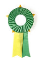 Award rosette green and yellow on a white background Stock Image
