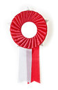 Award rosette red on a white background Stock Photography