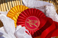 Award rosettes in equestrian sport with red and yellow colors Royalty Free Stock Photo