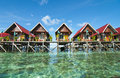Awesome view of mabul island budget lodge blue sky and green sea from Stock Photos