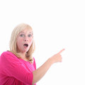 Awestruck woman pointing to blank copyspace Royalty Free Stock Photos