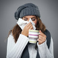 Awful flu young woman having and blowing her nose at handkerchief Stock Images
