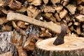 Ax stuck in a large timber Stock Photos