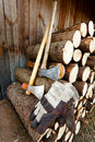 Axe, protective gloves and stack of logs Royalty Free Stock Photo
